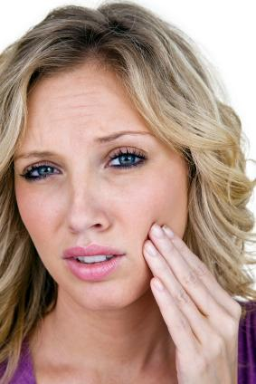 Woman with jaw pain | TMJ Therapy Charlestown NSW
