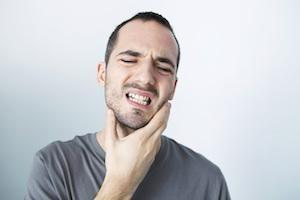 Man with jaw pain | TMJ Therapy Charlestown
